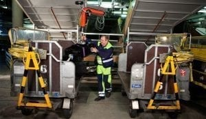 Vaculex Baggage Handling - Loading Baggage from Chute to Open Cart
