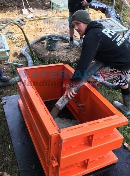 Emptying concrete pump into MCWM12 mould