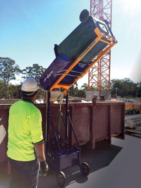 Electro-Hydraulic Wheelie Bin Tipper (150kg) in use on construction site