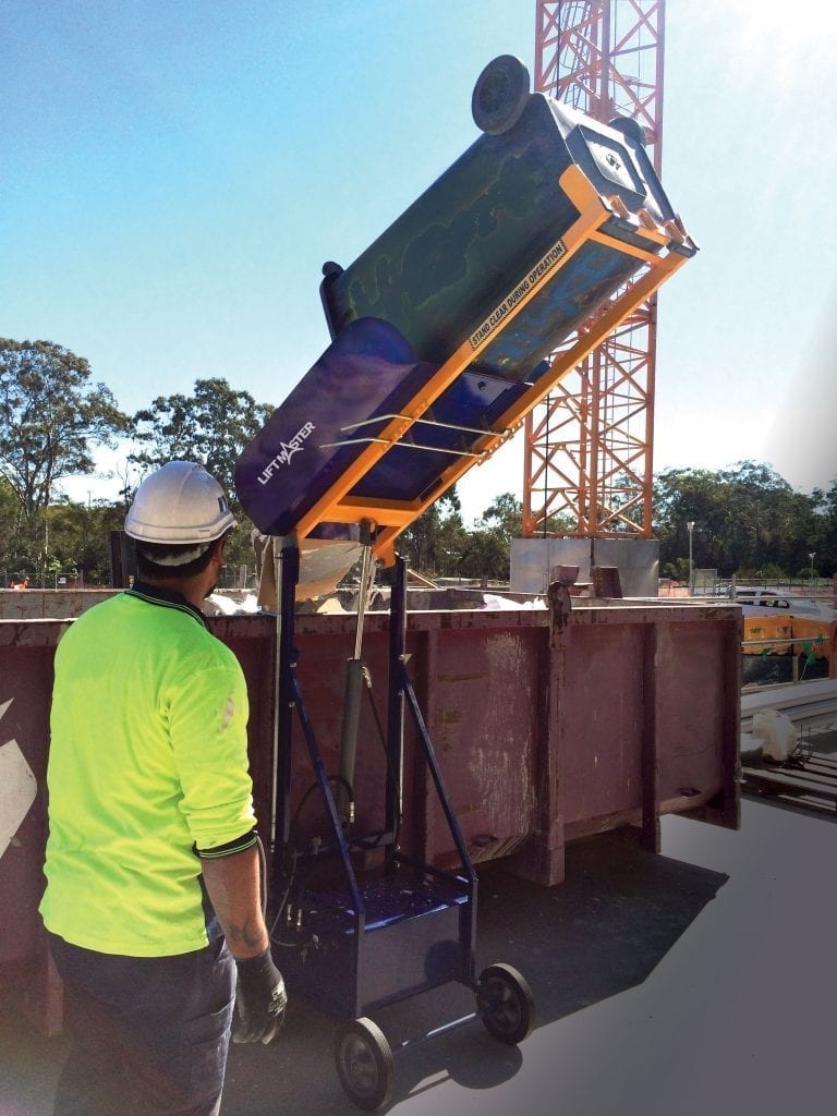 Electro-Hydraulic Wheelie Bin Tipper (150kg) in use on construction site