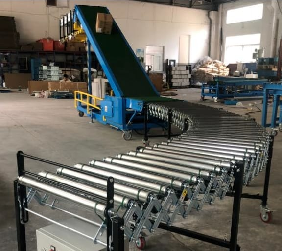 Unloader with powered conveyors each end