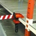 Skipper Retractable Barriers clamped onto surface