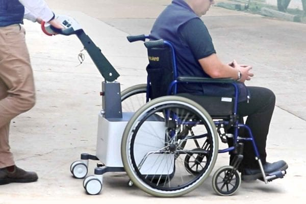 Powered wheelchair mover in action
